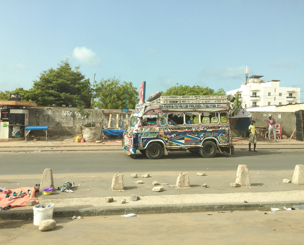 One of Dakar's  car   rapids , a colorful bus that offers cheap transportation in Senegal.