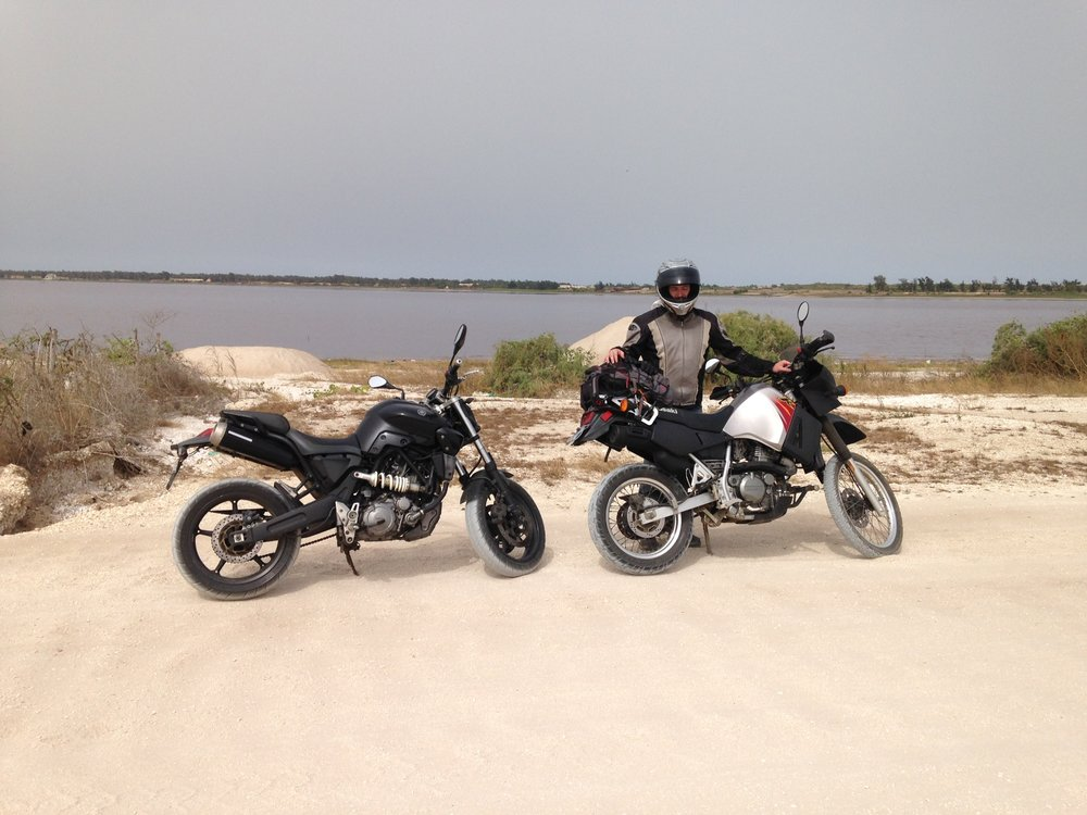 Gabriel with his KLR + bag of gear. This photo was taken on a trip to Lac Rose in November 2017.