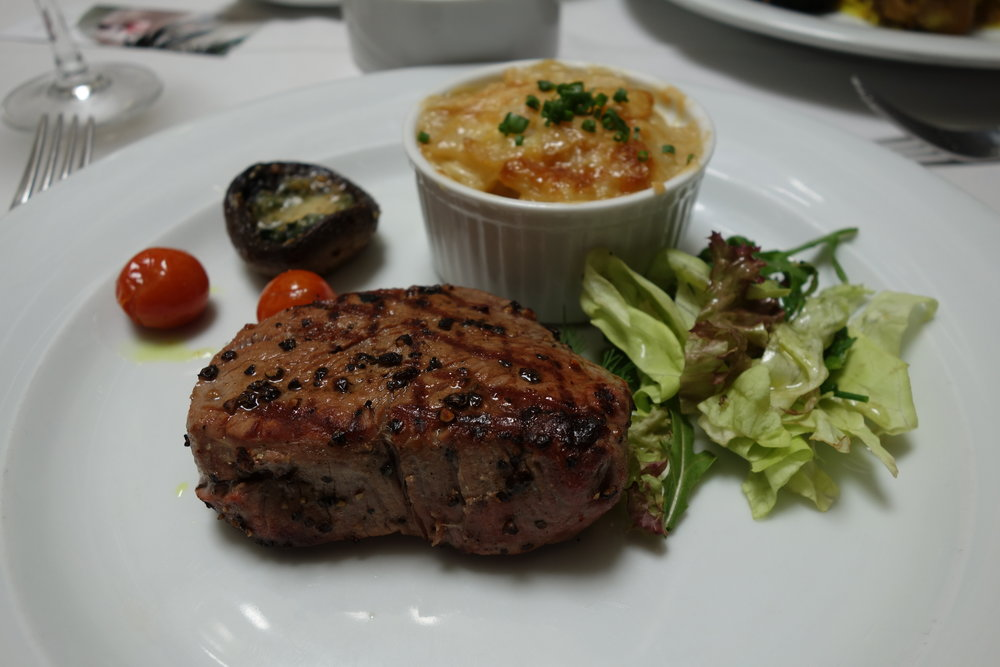 At Rick's Cafe, try the filet mignon, seared with black pepper.