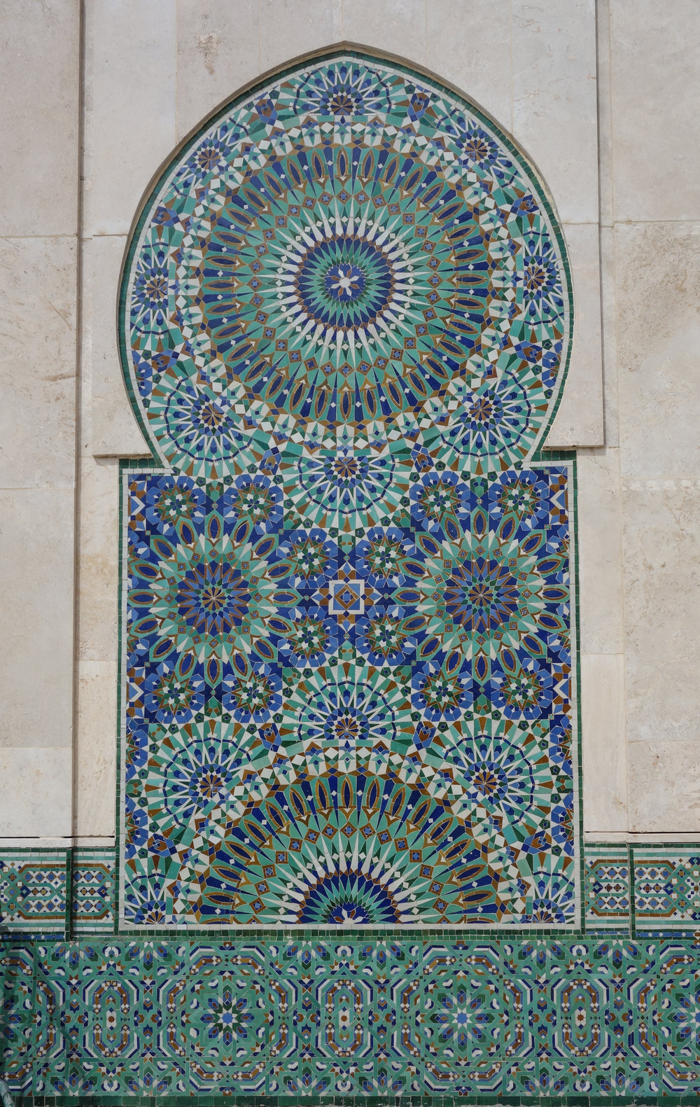 Moroccan architecture and blue-green tile work detailed in Casablanca.