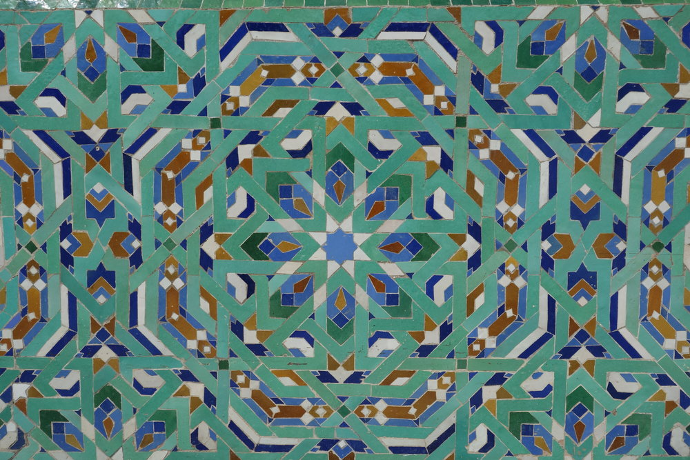 Intricate Moroccan artisan tiles decorate the outside of Hassan II Mosque in Casablanca.