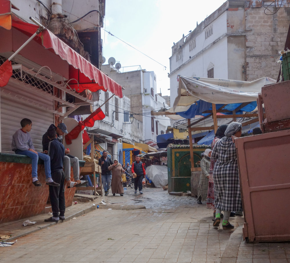 Neighbors shop or spend the afternoon together in the local market, only a few blocks between Hassan II Mosque and Casablanca's medina.
