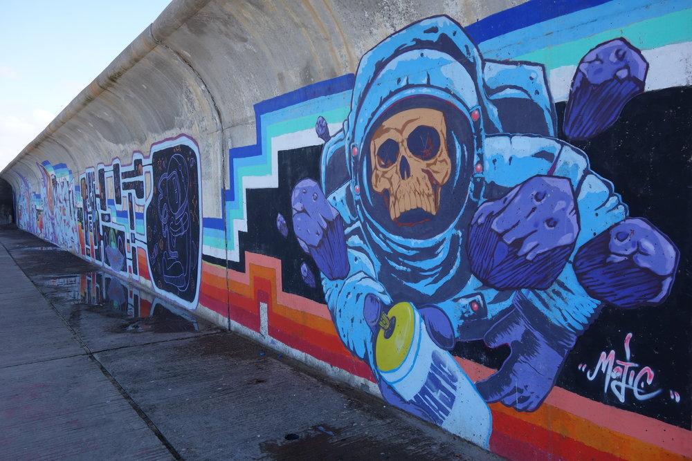 Graffiti artists paint messages along the promenade in Casablanca.