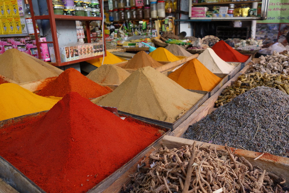 Spices are piled in large baskets in Rabat's medina, Morocco.