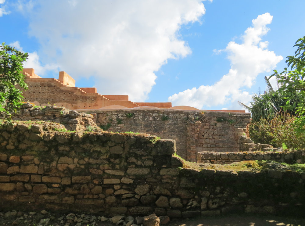 The ancient stone walls form a boundary around Chellah, with distinct architectural features hinting at its varied past.