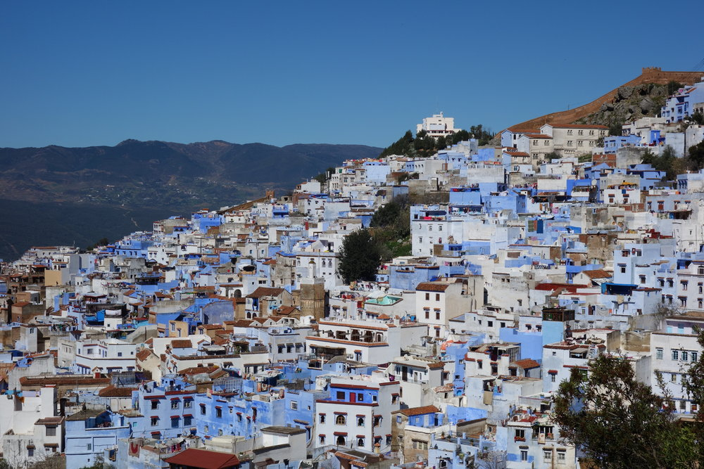 """""""The Blue City"""" or """"Blue Pearl of Morocco,"""" Chefchaouen's beautiful blue-washed walls are a stunning, must-see destination in the Moroccan mountains."""