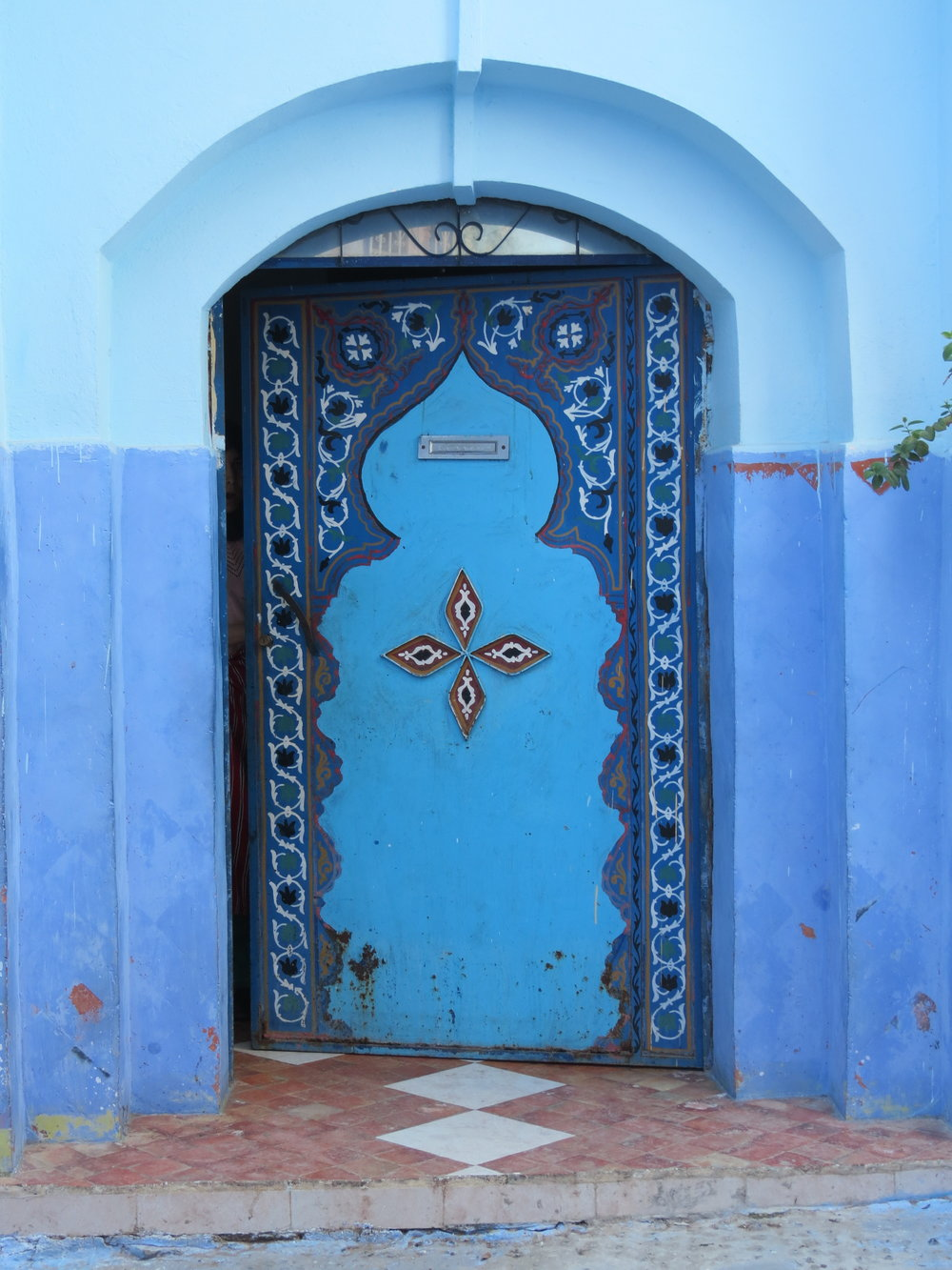 A blue keyhole door, traditional of Morocco. Found in Chefchaouen.