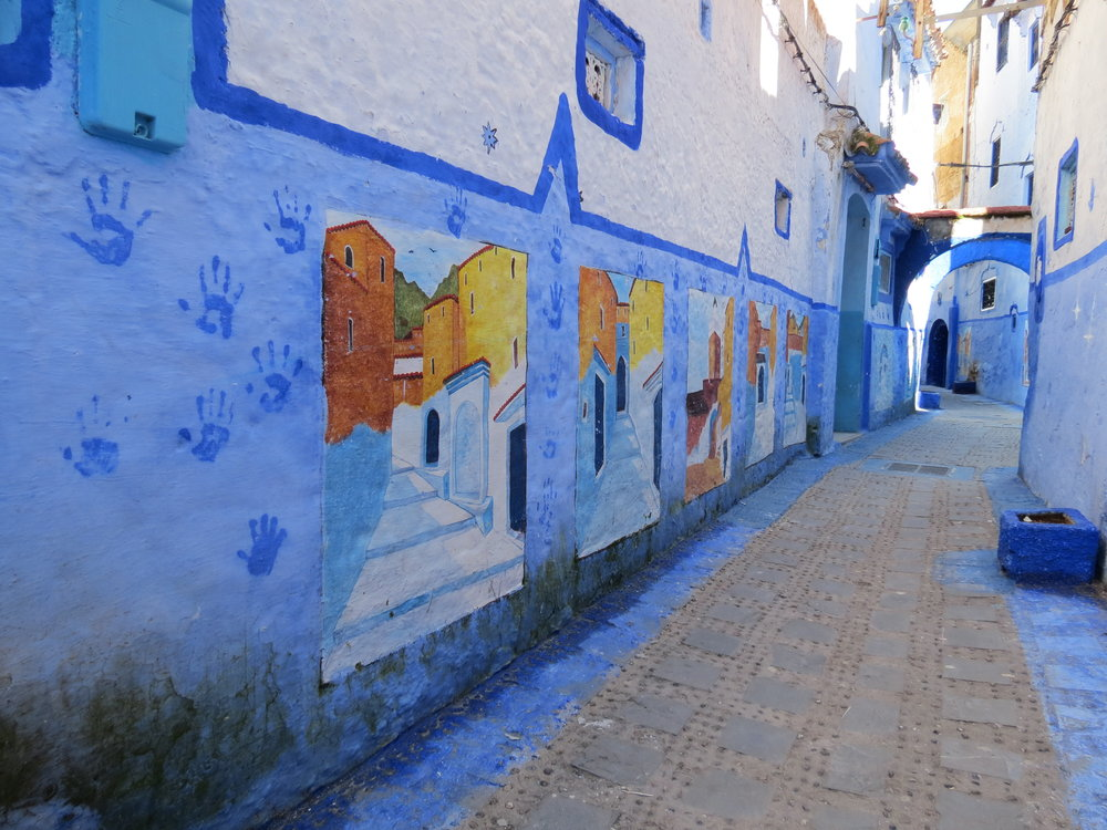 Blue-washed walls line the streets and sidewalks of Chefchaouen, Morocco.