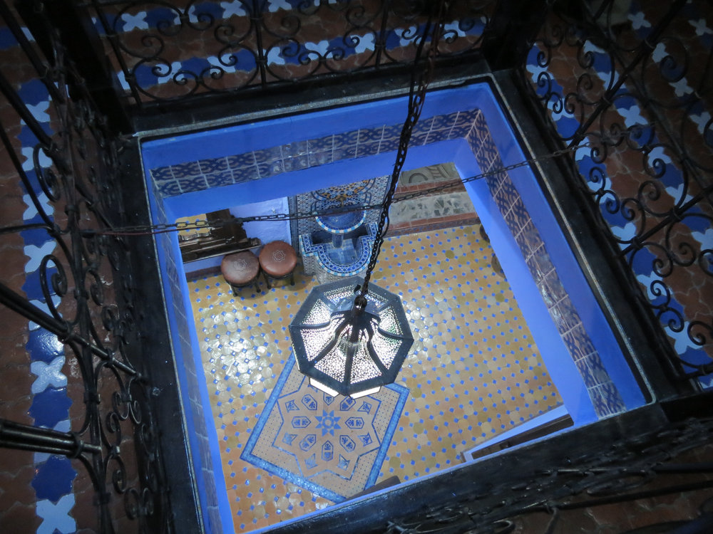 Influenced by the traditional riad, this Moroccan home features a three-story balcony looking into the lower entry.