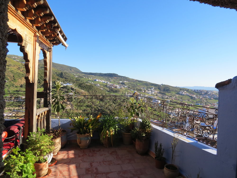 Beautiful mountain views can be seen from the rooftop terrace of Dar Lbakal in Chefchaouen, Morocco.
