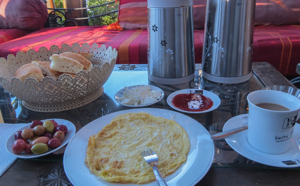 In Chefchaouen, we ate a traditional Moroccan breakfast of Berber bread, honey, goat cheese, olives, jam, and mint tea.