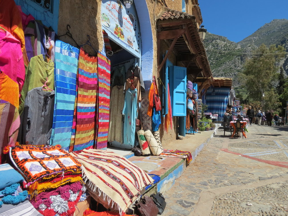 Shops in Chefchaouen selling blankets and other handmade g