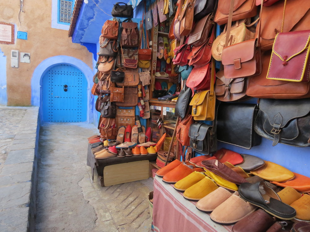 Artisans polish, dye, and carve intricate Moroccan designs into these leather handbags, found in Chefchaouen, Morocco. Explore the village's traditional souk and discover unique, one of a kind leather purses and leather bags.