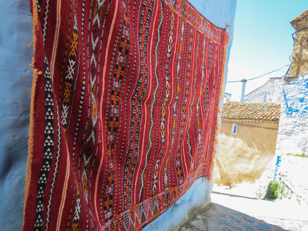 A red handmade Moroccan rug, crafted by artisans in Chefchaouen, Rif Mountains.