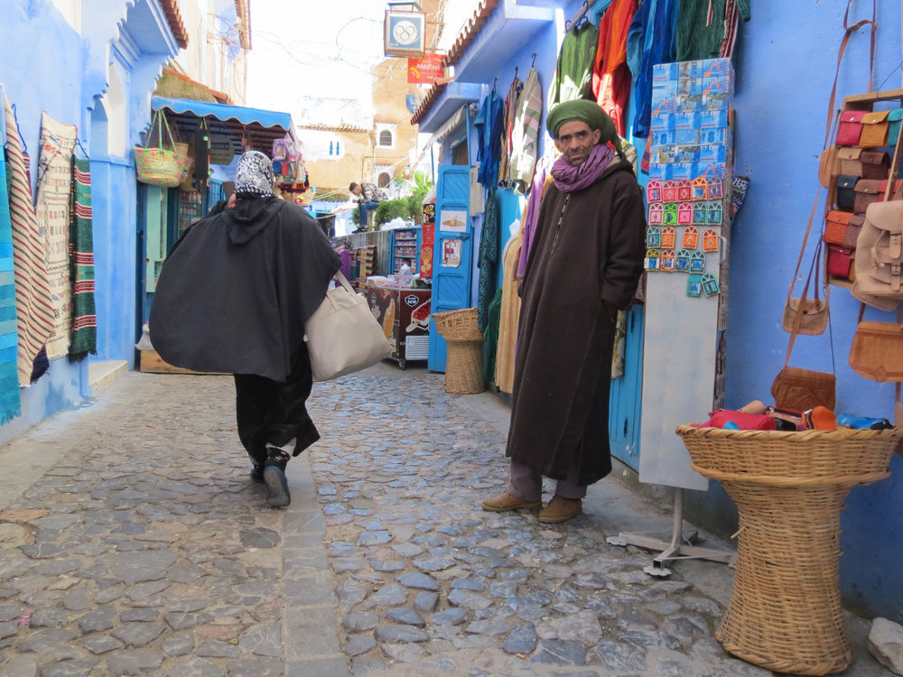Artisans sell handcrafted Moroccan goods in Chefchaouen's medina.