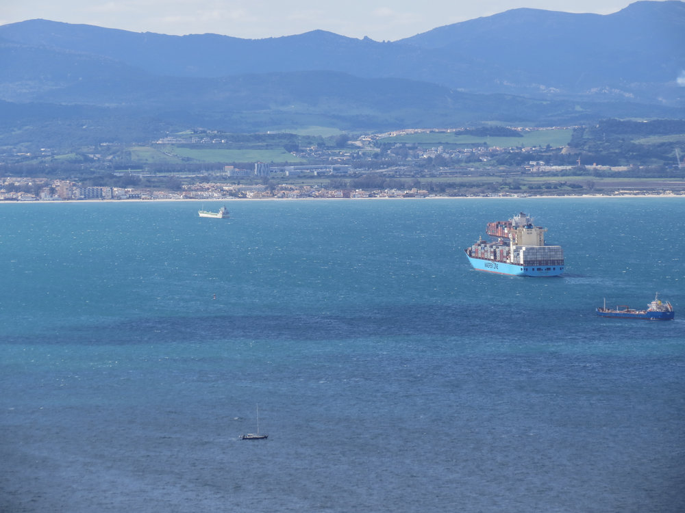A cargo ship delivering shipping containers to the port of Gibraltar.
