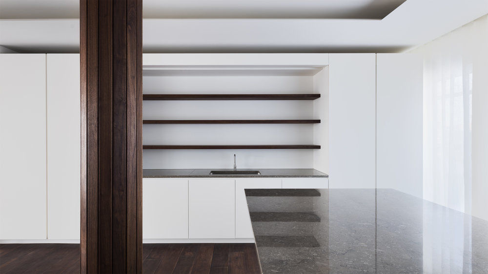 A clean contemporary kitchen, concealing a lot of the workspace.  Photography:  Rory Gardiner