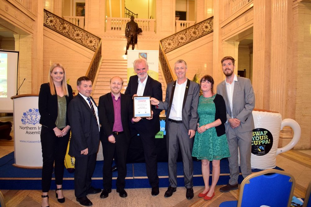 Certificate presentation from UK Fairtrade Foundation and Fairtrade Ireland declaring Northern Ireland as a Fairtrade Devolved Region (19 June 2017) in the Great Hall, Stormont Parliament Buildings, Belfast   (R-L): Adam Gardner, Communities Campaign Manager - UK Fairtrade Foundation; Anne Irwin, Director and Co-founder - Suki Tea; Dr Christopher Stange, Secretariat - All Party Group (APG) on Fairtrade & Hon. Consul for St. Vincent and the Grenadines to Northern Ireland; Tim McGarry; Steven Agnew MLA, Chairperson - APG on Fairtrade; Robin Swann MLA, Member - APG on Fairtrade; Emma Daly, Business Development Manager - Fairtrade Ireland