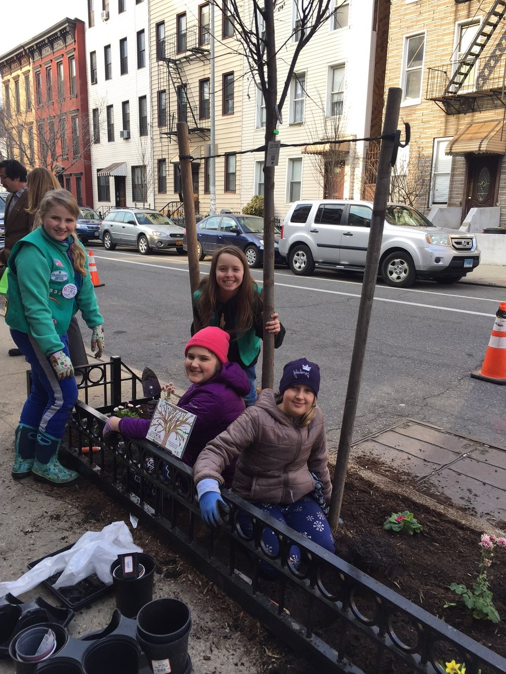 St. Stans Girl Scout Troop 2832 hard at work planting perennials in the tree bed