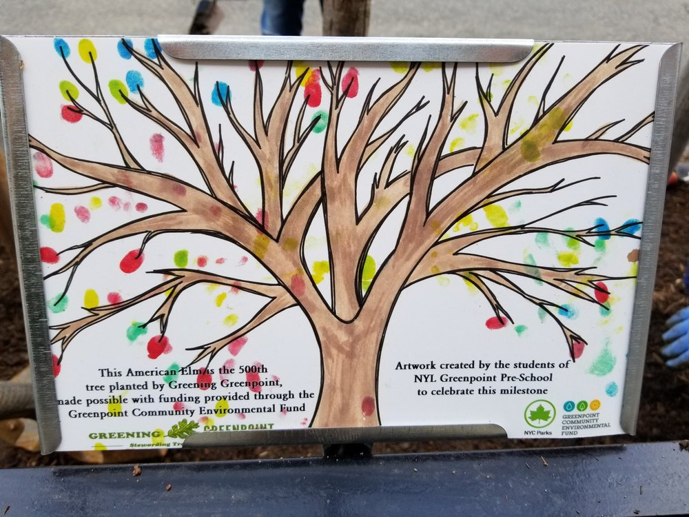 Sign for the tree bed featuring artwork created by the students of NYL Greenpoint Pre-School