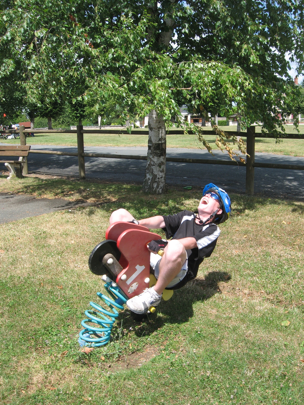 young person enjoying playground