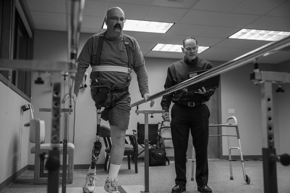 Jeff Gilbert working with one of our patients to perfect the settings of his Linx limb system.