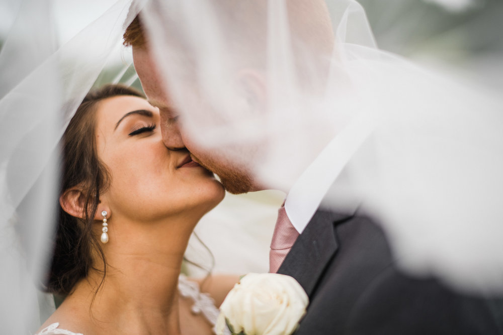 Romantic Veil Shot of Bride and Groom | Des Moines, IA Photographer Austin Day