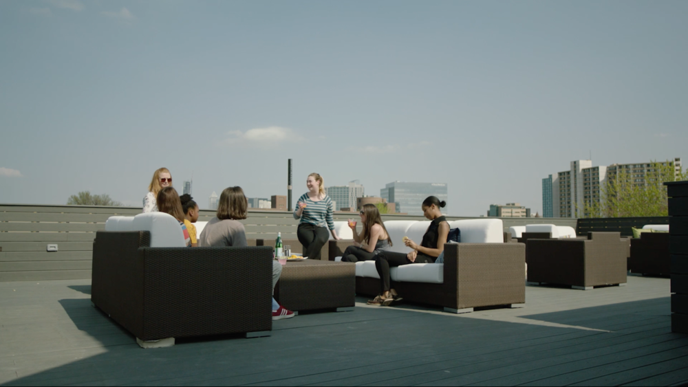 Residents and staff hanging out on the roof.