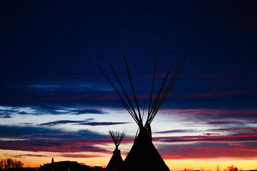 tepees at sunset