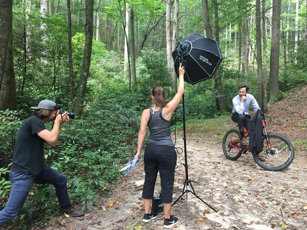 The author and Co-founder of Unsettled  in front of the cameras, and on a bike, for  Forbes earlier this year