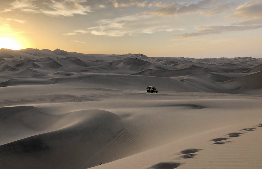 """The gigantic rolling sand dunes of Huacachina presented the perfect playground! Señor rapido, our buggy driver, massacred the dunes and left us in splits and shrieks. There was also sand boarding, sunset over the oasis town and a party that went into the wee hours of the morning... 6:30AM to be precise…"" -"
