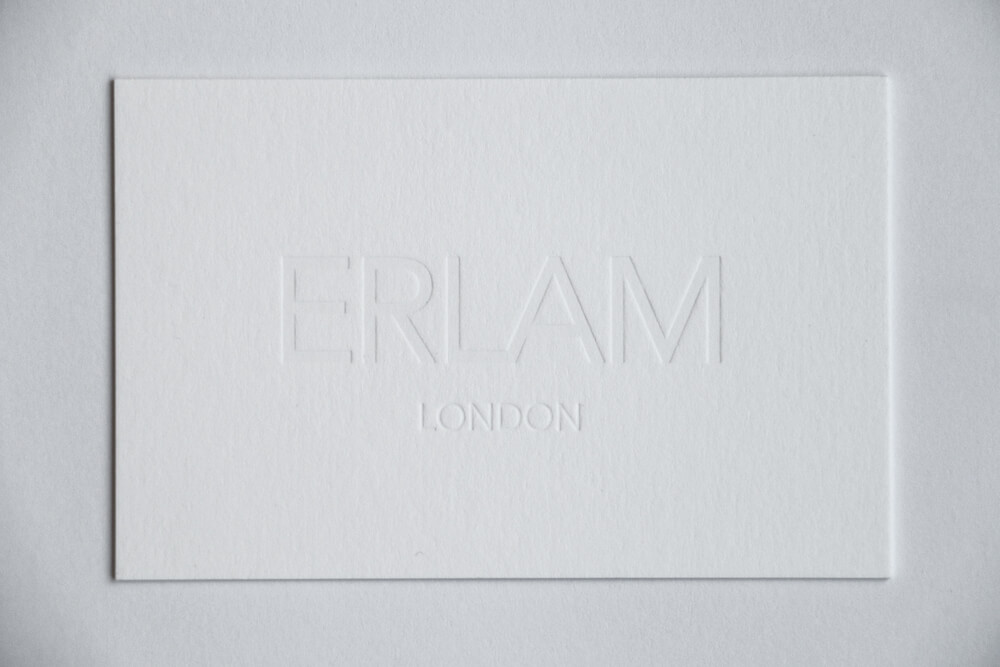 White business card designed with indented logo