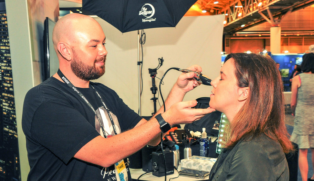 Airbrush foundation and touch-ups at the Aprimo Headshot Booth, photo by New Orleans Event Photography
