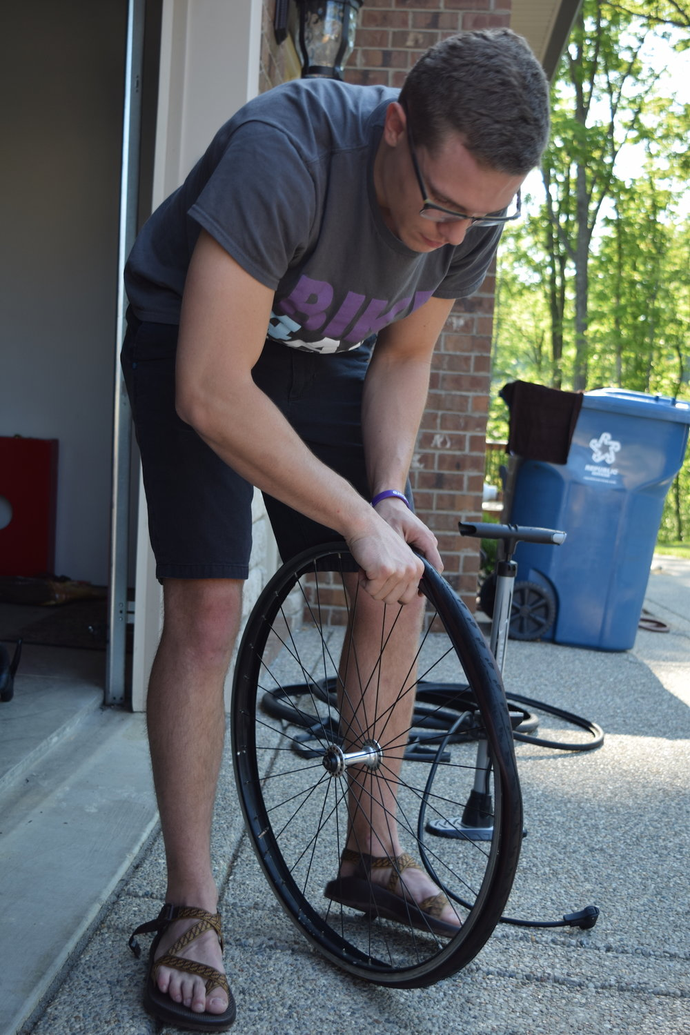 Alex replaces his tire at Logan's house before we leave Louisville.