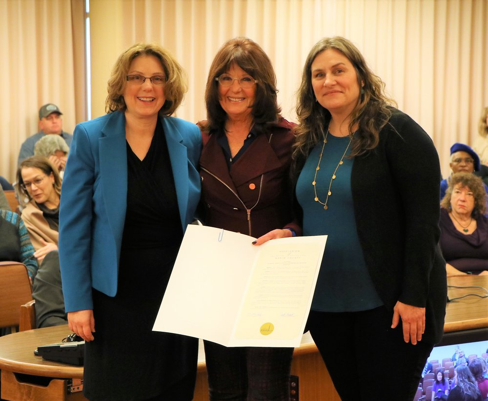 (  From left) Rosemary Slote of the DA's Office, Supervisor Judy Arnold and Gina Vucci of the Marin Coalition to End Human Trafficking pose with the Board of Supervisors resolution on January 23.