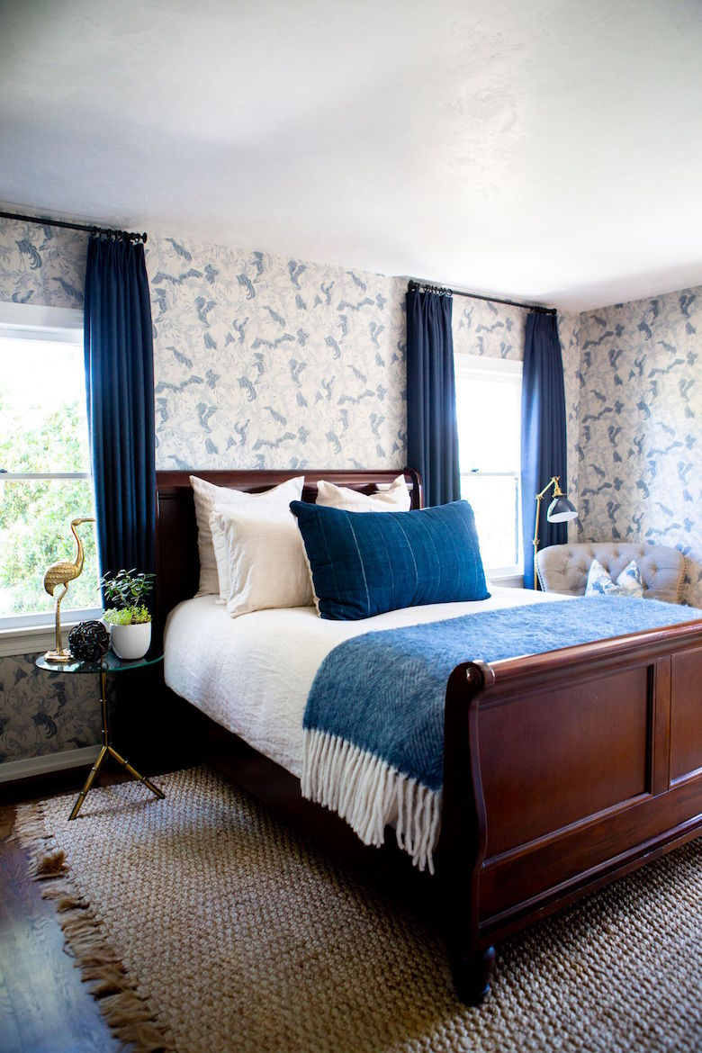 Sara's guest room featuring our indigo lumbar pillow and side table arrangement.