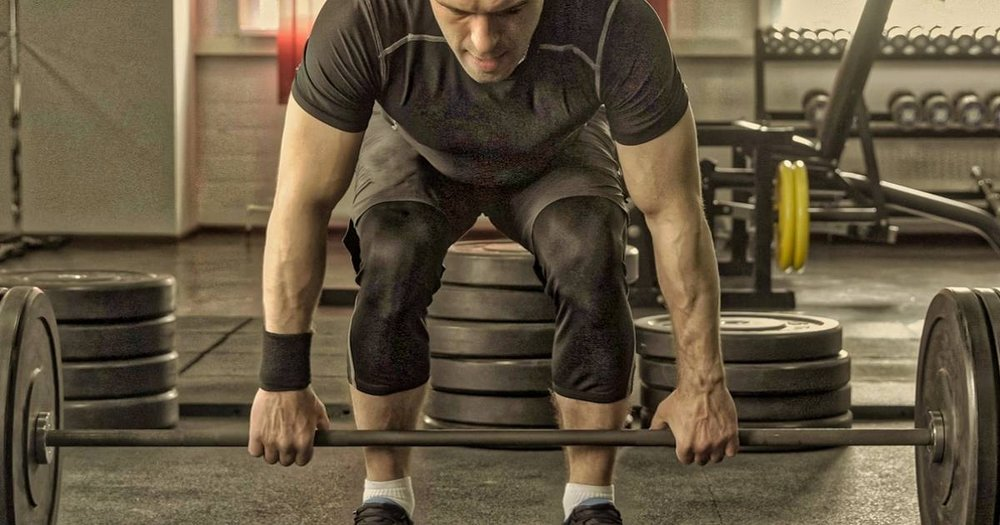 man getting ready to clean deadlift