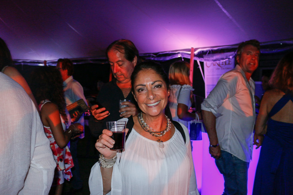 Beautiful people gathered on a beautiful night for a good time in Bridgehampton, New York.