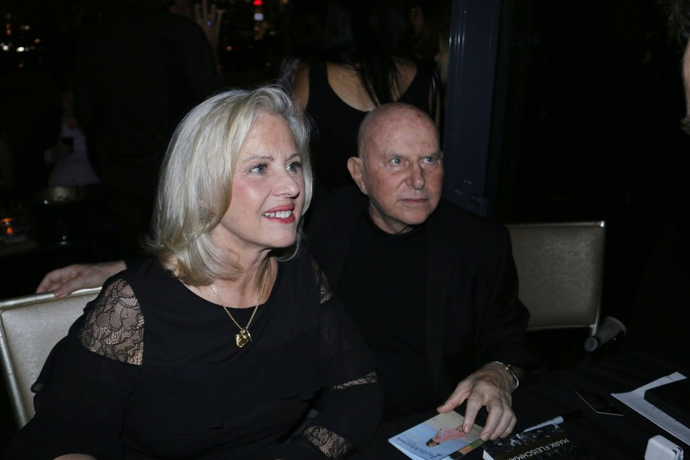 Mark Fleischman with his wife, Mimi Fleischman celebrating the debut of their book, Inside Studio 54.