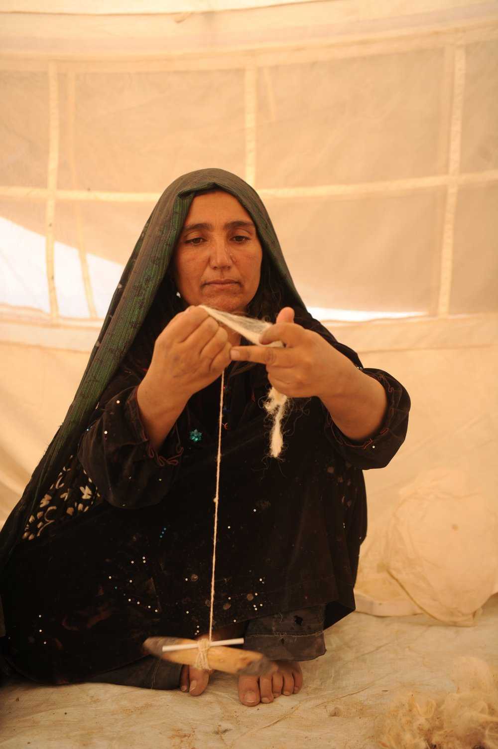 Internally Displaced Person spinning silk yarn in Herat province, courtesy of EFI Afghanistan, supported by the European Union