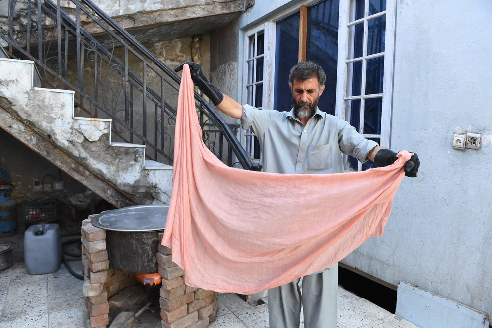 Returnee from Pakistan dying raw silk scarf, courtesy of EFI Afghanistan, supported by the European Union