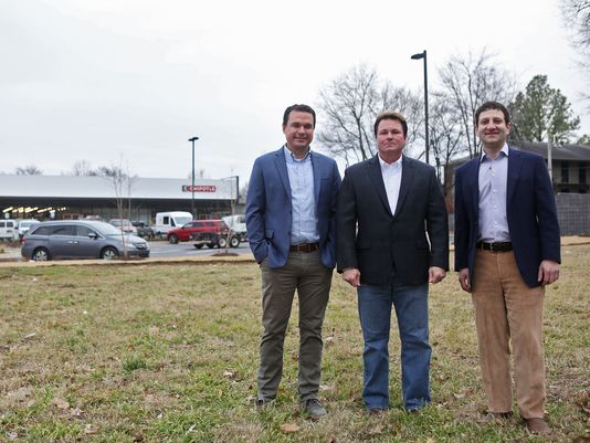 February 6, 2018 - Left to right - Aaron Petree, Cliff McLemore and Ed Thomas, with PMT Investments, stand in a lot at 43 Diana where Flats at Overton Square will be built over the coming year. Flats at Overton Square will be a 16-unit, three-story live/work development.