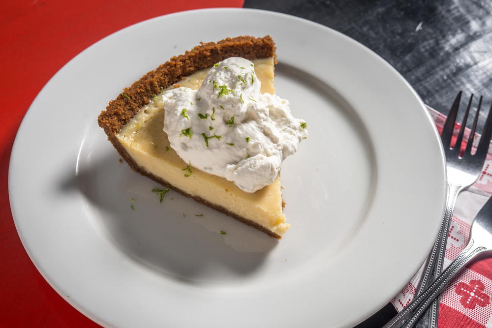 Made with freshly squeezed juice, homemade graham crackers, and the creamiest custard you've ever tasted, our Key Lime pie is bright, tart, and a slice of sunshine, year-round. Top with a dollop of whipped cream for a classic Floridian treat!