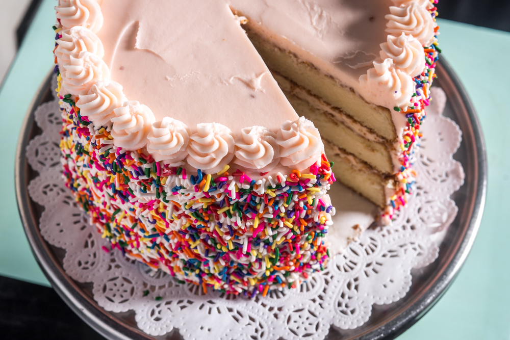 Super-Moist Vanilla Cake, Pink Frosting & Rainbow Sprinkles Declared the BEST Birthday cake in NYC!  *Please Note: We need 48 hours notice for all whole cake orders, and the only color frosting you can get for the Birthday Cake is PINK!*