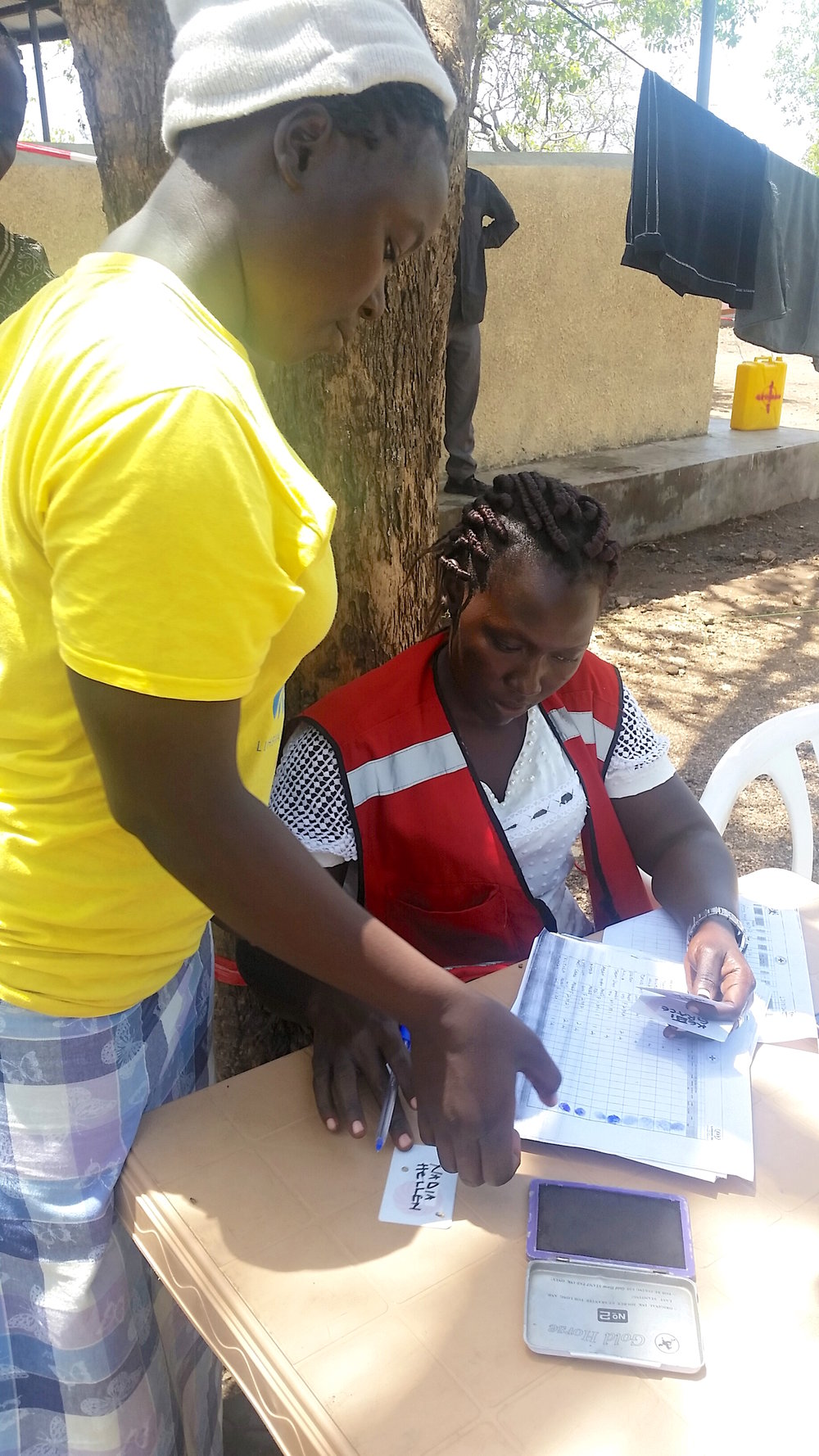 ChildVoice student Nadia registers as a South Sudanese refugee, having joined the program in March, 2016, before war broke out in South Sudan. Now the majority of her community from the city of Yei has fled to the camps in Uganda for safety.
