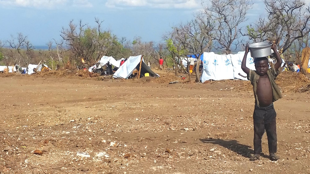 "New ""permanent homes"" are erected for the South Sudanese refugees. Most are coming across the border with nothing but the clothes on their backs. These tarp tents are meant to protect them from all the elements: rain, wind, and soaring African heat."