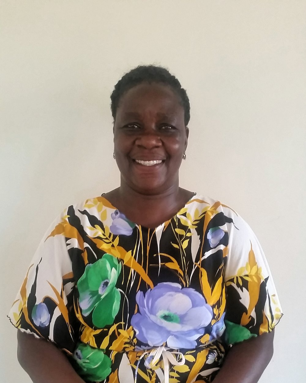 <strong>Winnie Acayo</strong><br>Post Residential Counselor
