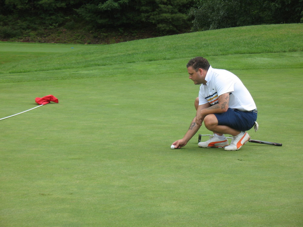 Jeffrey, one of the True Fit golfers, lining up to sink his putt