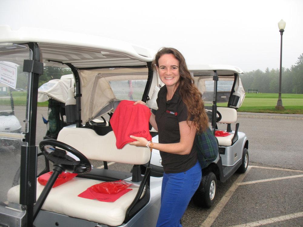 Kelsi Kautz, ChildVoice staff member, greets golfers