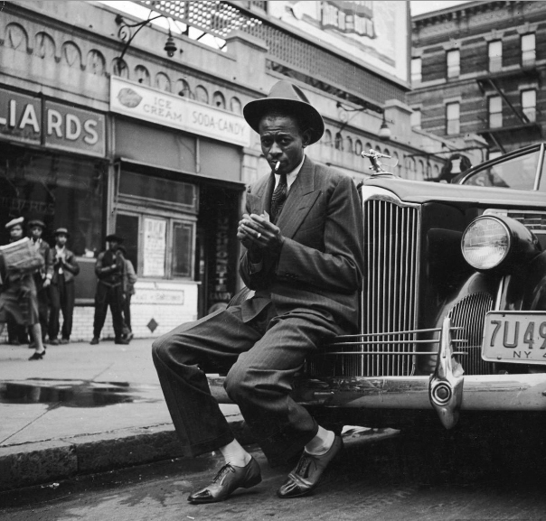 "CLASSIC HARLEM. expressionsrealia: LIFE Archives - 1941: ""Baseball player Satchel Paige, looking dapper, lighting his cigarette while sitting on front bumper of large car outside poolroom in Harlem."""